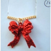 RED GLITTER RIBBON BOW PENDANT NECKLACE - Valentines Day Christmas Jewelry - Sparkle plastic ruby color charm bows, approx. 1-inch (2.5cm) tall on 18-inch (45cm) neck chain with safety clasp.